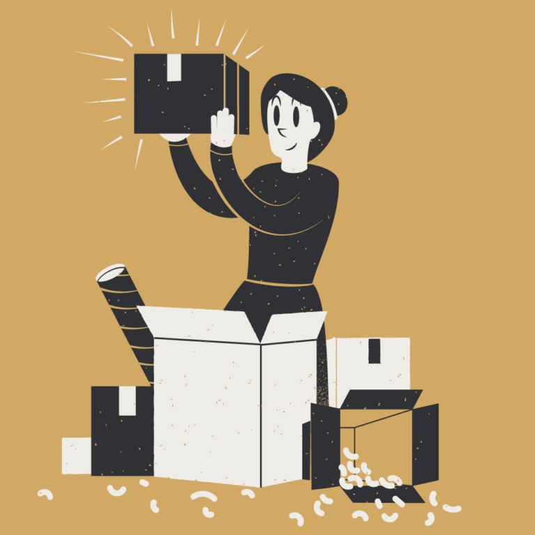 An entrepreneur is surrounded by packaging and shipping items. She holds up a box that is ready to send to a customer.